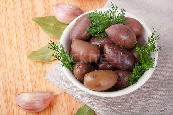 Zwarte gezouten olijven witte schotel voedsel Stockfoto © Artspace