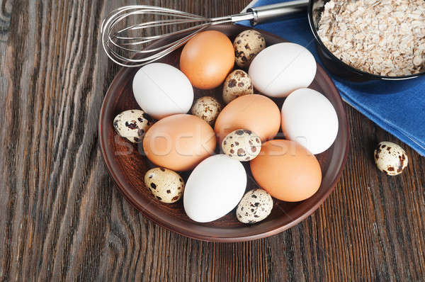 Quail and chicken eggs in a clay plate Stock photo © Artspace