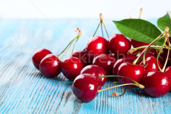 Red sweet cherry and green leaves Stock photo © Artspace