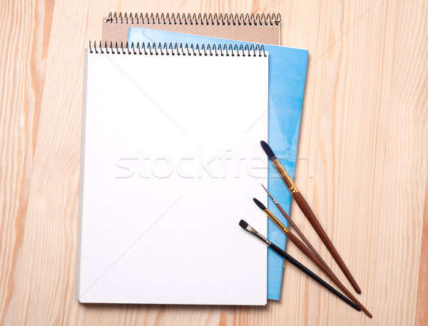 Blank notebook and brushes Stock photo © Artspace