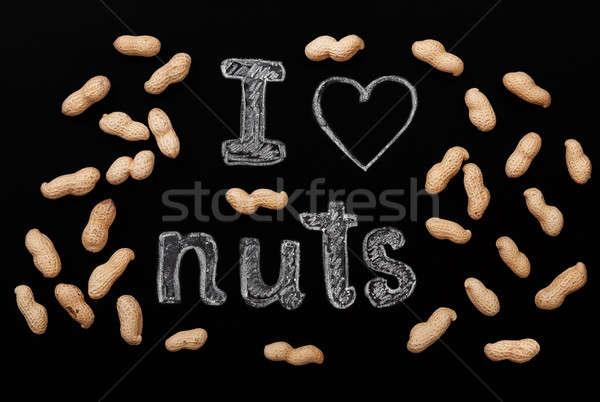 Peanuts on a black background Stock photo © Artspace