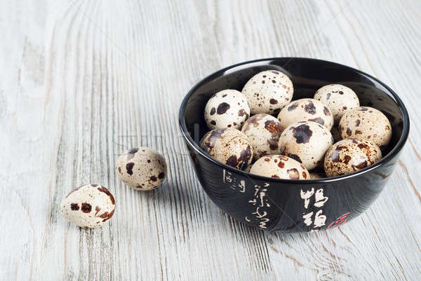 Quail eggs in a black dish Stock photo © Artspace