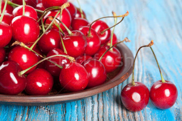 Cherry in a clay dish Stock photo © Artspace