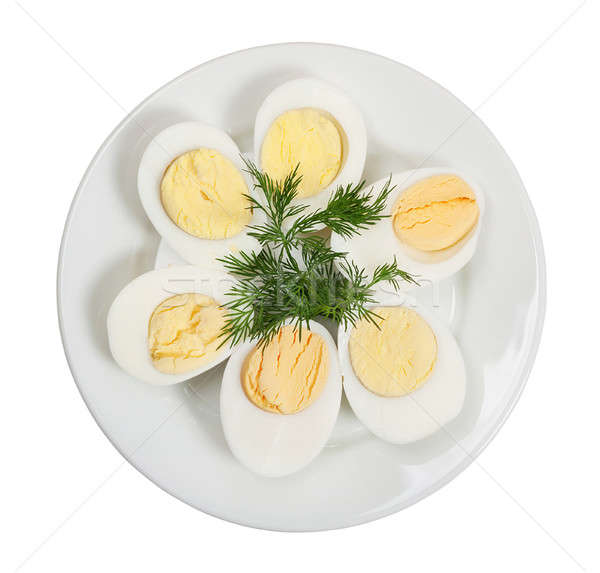 Boiled hen eggs in white plate Stock photo © Artspace