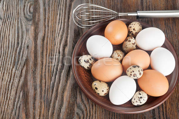 Quail and chicken eggs Stock photo © Artspace