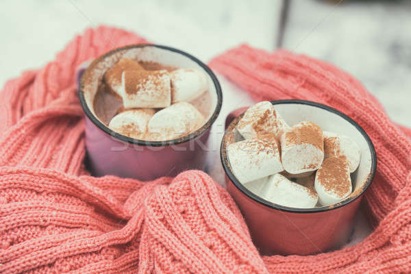Hot chocolate with marshmallow in pink and violet two cups wrapp Stock photo © artsvitlyna