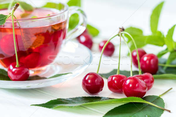 Stock photo: Cherries and cherry flavored drink in glass cup