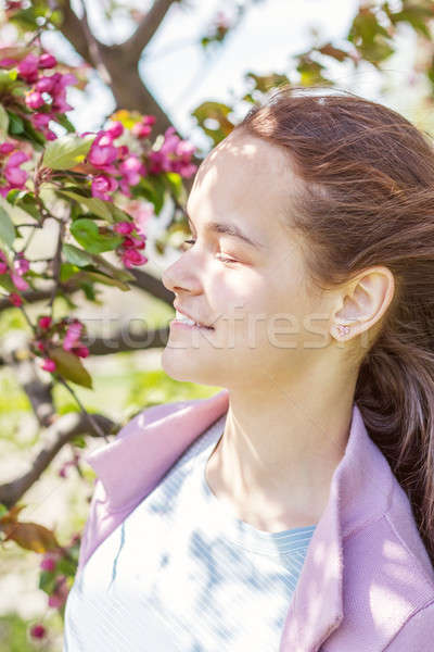 Cute young girl in an apple orchard Stock photo © artsvitlyna