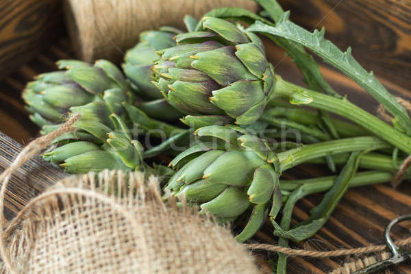 Stock photo: Artichoke bouquets on sackcloth on wooden background