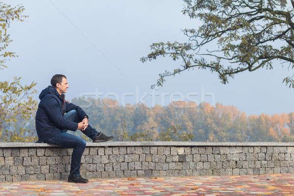 Handsome man in the autumn park Stock photo © artsvitlyna