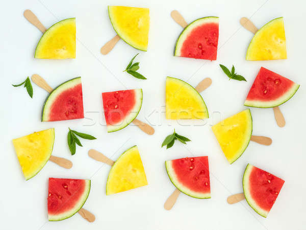 Stock photo: Red and yellow watermelon slices on sticks