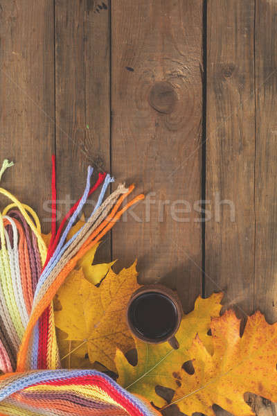 Multicolored scarf, cup of coffee, yellow maple and oak leaves o Stock photo © artsvitlyna