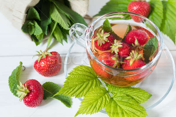 Stock photo: Fresh strawberry and summer tea.