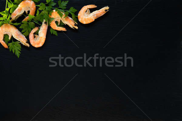 Preparing fresh seafood in the kitchen Stock photo © artsvitlyna