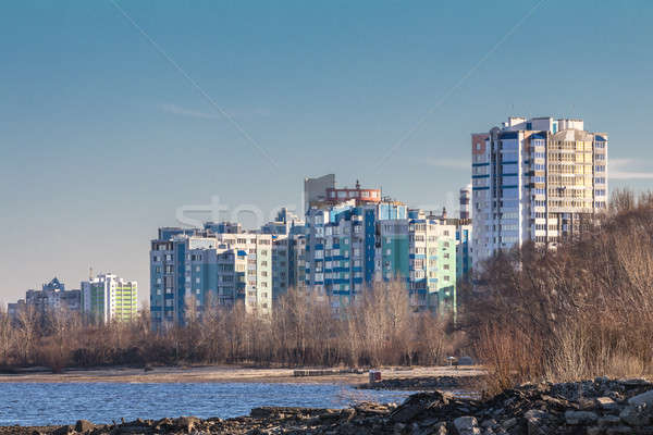 Stock photo: Cityscapes and skyline in clear blue sky on view from river. Sun