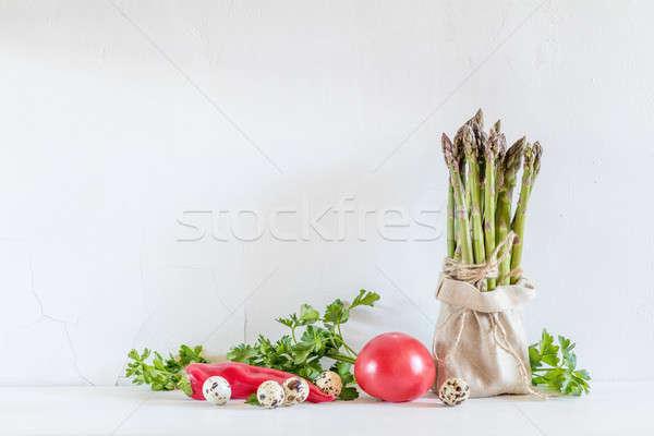 Fresh vegetables and asparagus in a little sack Stock photo © artsvitlyna