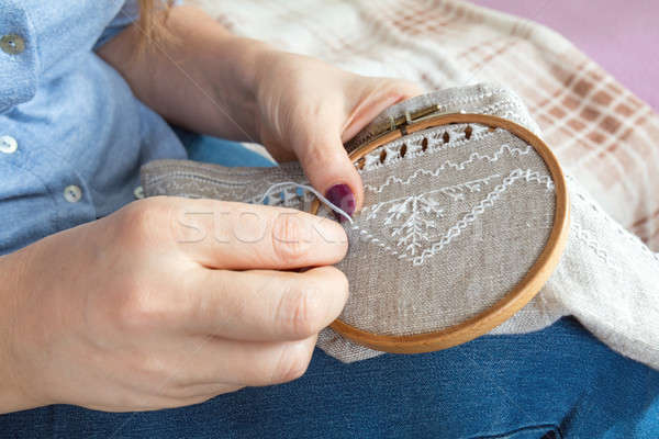 Woman hands doing openwork embroidery on homespun linen.  Stock photo © artsvitlyna