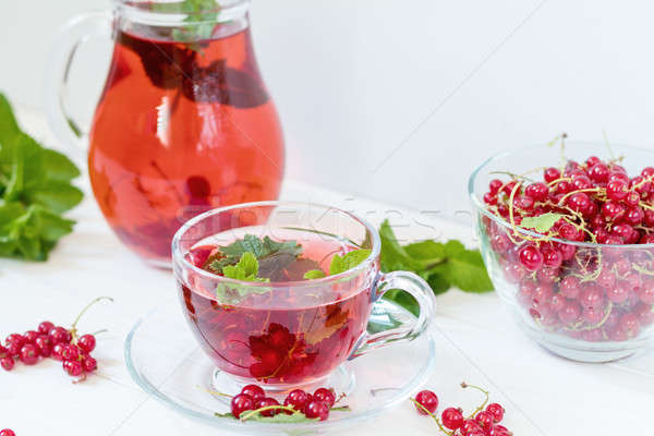 Stock photo: Redcurrant drink in transparent glass carafe and cup