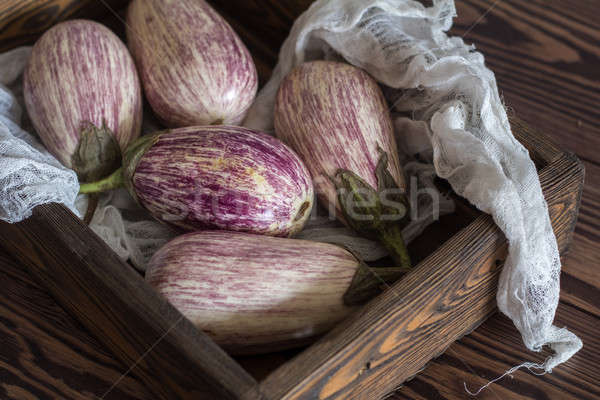 Purple graffiti eggplants on vintage background Stock photo © artsvitlyna