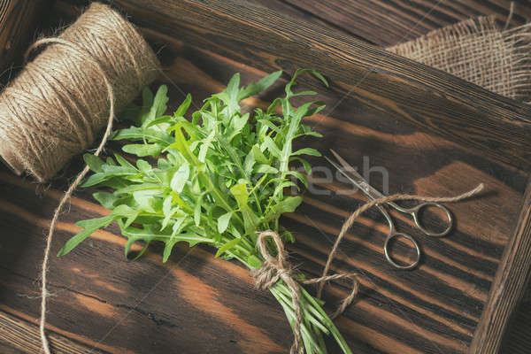 Fresh arugula bouquet in wooden box Stock photo © artsvitlyna