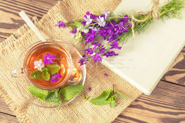Glass cup of summer tea with herbs Stock photo © artsvitlyna