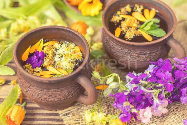 Ceramic cups of healthy herbal tea Stock photo © artsvitlyna