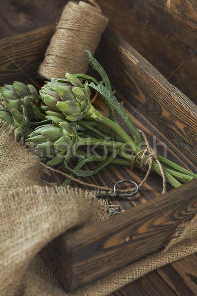 Artichoke bouquet in wooden box Stock photo © artsvitlyna