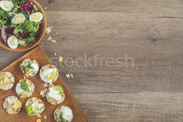 Nutritious cereal breads with cream cheese on wooden surface Stock photo © artsvitlyna