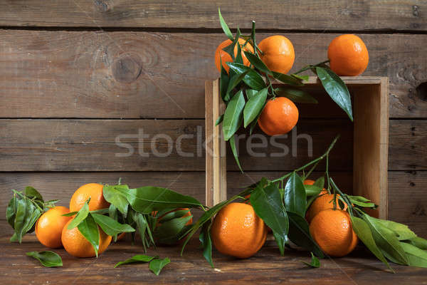 Stock photo: Tangerines with leaves on wooden box