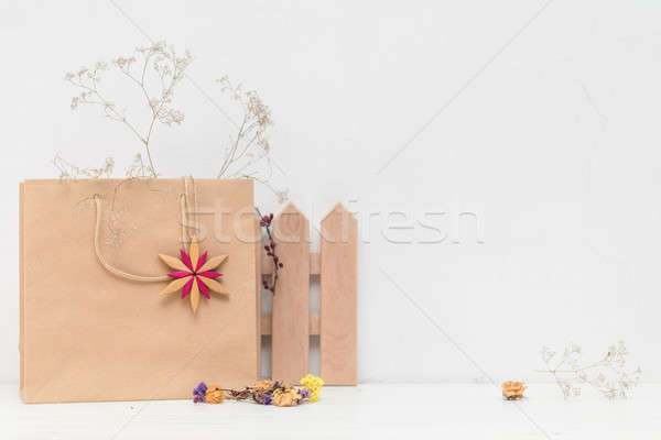 Composition of dried flowers and decoration on white cracked wal Stock photo © artsvitlyna