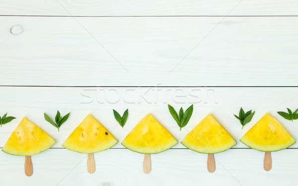 Amarelo melancia fatias brilhante branco Foto stock © artsvitlyna