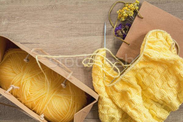 Light yellow knitting wool and knitting needles on wooden backgr Stock photo © artsvitlyna