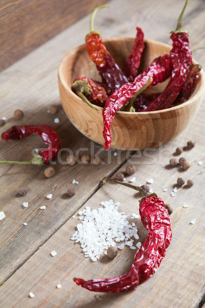Stock photo: Dried chili peppers in a wooden bowl