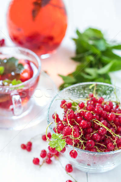 Stock photo: Fresh redcurrant with dew drops in transparent glass vase