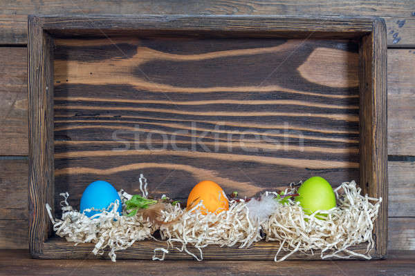 Easter colorful eggs in the nests in cell boxes. Beautiful easte Stock photo © artsvitlyna