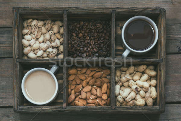 Cups of coffee on dark wooden background. Stock photo © artsvitlyna