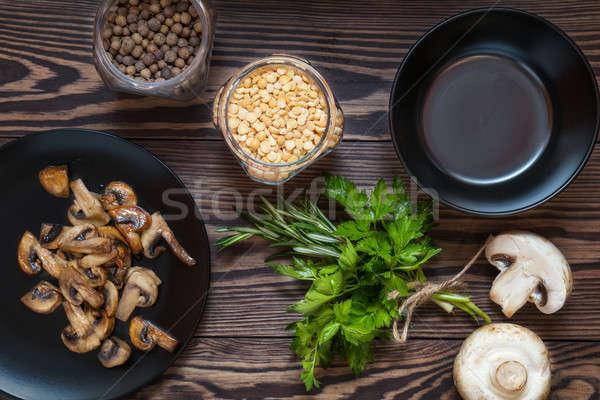 Fried mushrooms in black plate Stock photo © artsvitlyna