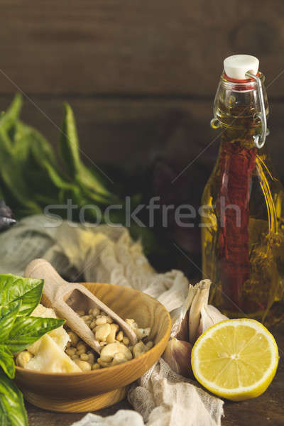 Stock photo: Many food ingredients for making pesto on dark wooden background
