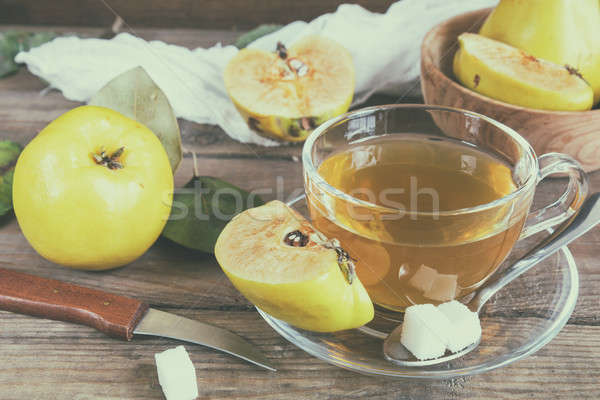 Cup of hot  tea and fresh quince fruit on table Stock photo © artsvitlyna