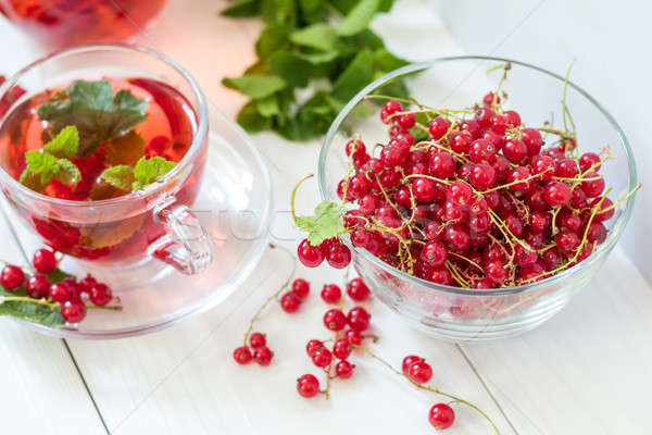 Stock photo: Fresh redcurrant in transparent glass vase