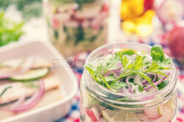 Salads with vegetables and sliced herring fillets Stock photo © artsvitlyna