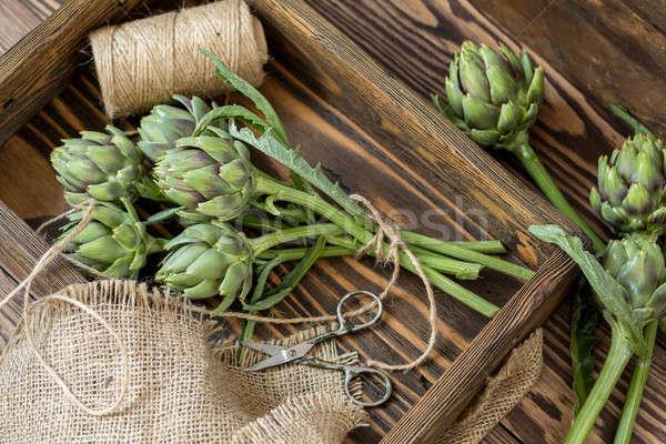 Stock photo: Artichoke bouquet in wooden box
