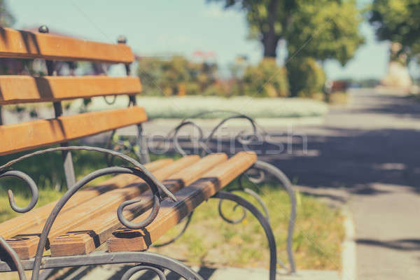 Stock photo: Summer footpath in the city park with a bench on a sunny day. To