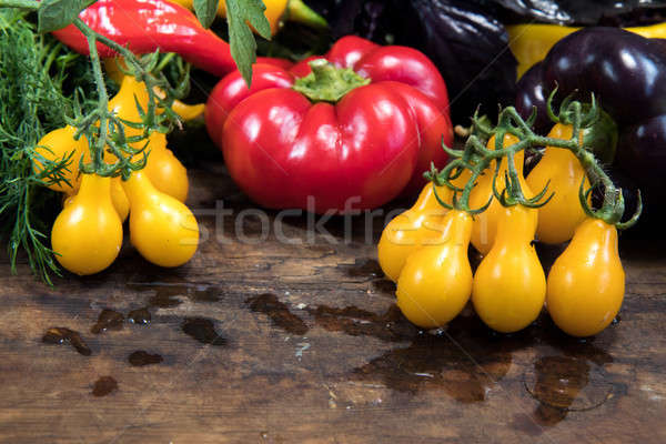 Stock photo: Red and purple sweet pepper and yellow tomatoes