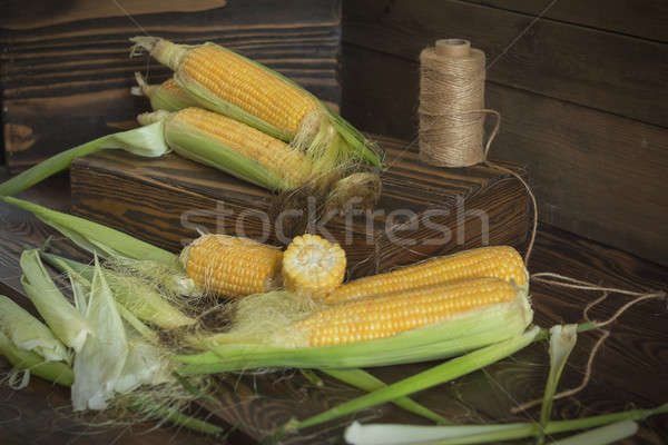 Fresh sweet corn on cobs on rustic wooden table Stock photo © artsvitlyna