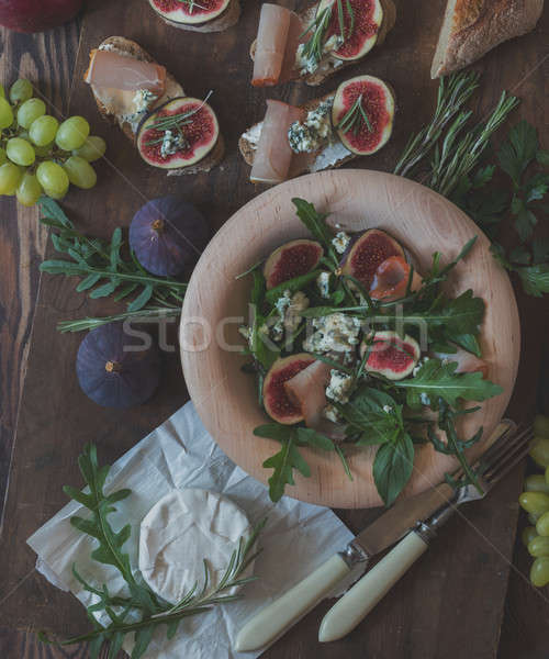 Stock photo: Easy diet salad with arugula, figs and blue cheese