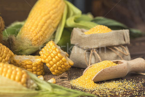 Fresh corn on cobs on rustic wooden table, top view. Dark wooden Stock photo © artsvitlyna