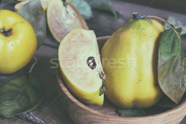 Stock photo: Fresh quince fruit on dark wooden table