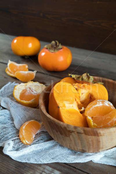 Fresco frutas tigela escuro comida Foto stock © artsvitlyna