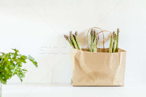 Stock photo: Fresh asparagus in a paper bag